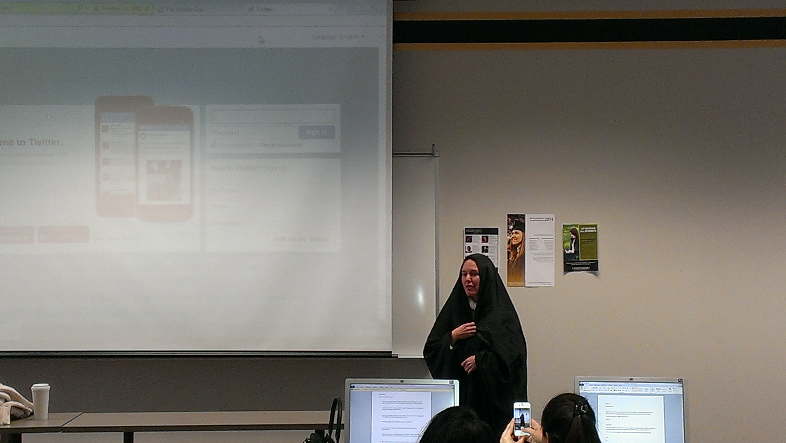 Horan showing our class a traditional Iranian chador, an open cloak worn by many women in Iran.