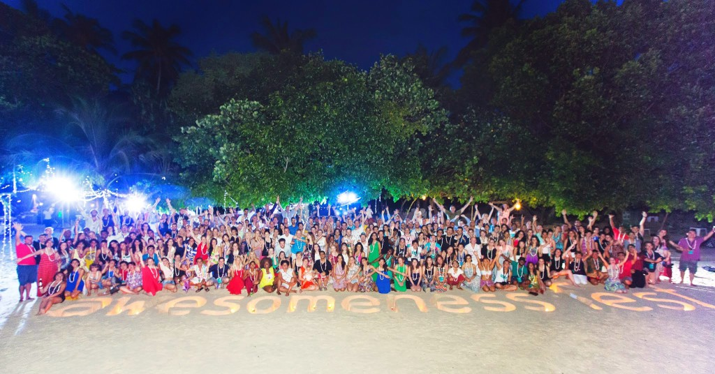 The whole Tribe on the beach of a private island ready for the closing event on the last day.